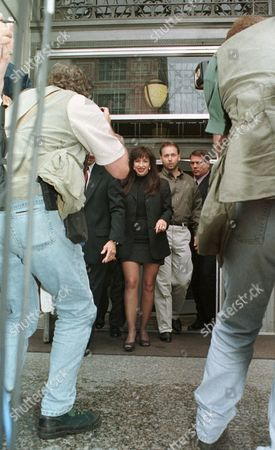 PAULA JONES Paula Jones, center, walks toward photographers as she leaves the Little Rock, Ark., federal courthouse . A federal judge set May 27, 1998, as the trial date for Jones' sexual harassment lawsuit against President Clinton