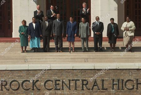 """CLINTON HUCKABEE DALEY The Little Rock Nine"""" gather on the steps of Central High School in Little Rock, Ark., with President Clinton, top right, Arkansas Gov. Mike Huckabee, center, and Little Rock Mayor Jim Daley, . """"The Little Rock Nine"""" from left, are Thelma Mothershed Wair, Minnijean Brown Trickey, Jefferson Thomas, Terrence Roberts, Carlotta Walls LaNier, Gloria Ray Karlmark, Ernest Green, Elizabeth Eckford and Melba Pattillo Beals"""