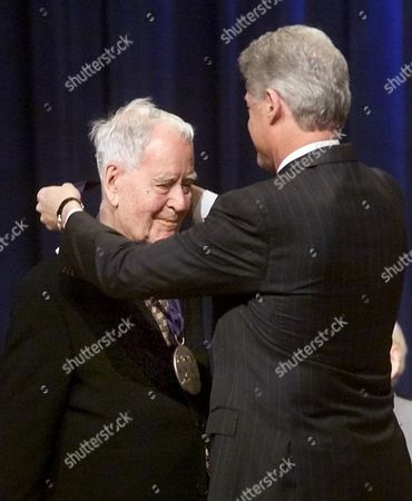 FOOTE CLINTON President Clinton presents Houston playwright Horton Foote with a National Medal of Arts during a ceremony at DAR Constitution Hall in Washington