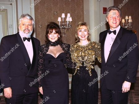 President-elect Bill Clinton, right, and his wife Hillary, second from right, joined Hollywood friend Harry Thomason and his wife Linda Bloodworth-Thomason at the Ritz-Carlton Hotel in Pasadena, Calif., Saturday. The event was a surprise birthday party for Bloodworth-Thomason. Hillary was wearing a gown that is four years old, and she last wore at the Governor's Ball in Arkansas