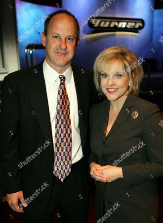 """GRACE WALTON Legal analyst Nancy Grace, anchor of daily trial coverage on Court TV, poses Jim Walton, president of CNN News Group, as she talks about her upcoming new duties on CNN Headline News at a meeting of the Television Critics Association, in Universal City, Calif. Grace will soon host a nightly talk show """"Nancy Grace"""" on CNN Headline News in addition to her daily Court TV appearances. CNN is part of the Turner Broadcasting System"""