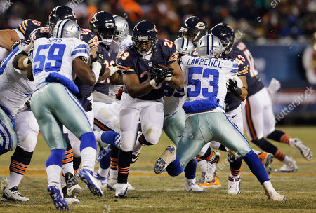 Matt Forte Chicago Bears running back Michael Bush (29) rushes against Dallas Cowboys defenders during the second half of an NFL football game, in Chicago