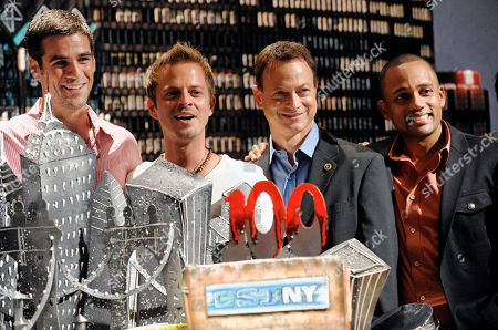 """Eddie Cahill, Carmine Giovinazzo, Gary Sinise, Hill Harper CSI:NY"""" cast members, from left, Eddie Cahill, Carmine Giovinazzo, Gary Sinise and Hill Harper pose together during a celebration of the show's 100th episode at CBS Paramount Studios in Los Angeles"""