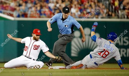 Daniel Murphy, Ben Zobrist, Lance Barrett Washington Nationals second baseman Daniel Murphy (20) can't make the tag on Chicago Cubs' Ben Zobrist as Zobrist slides into second base for a double, with umpire Lance Barrett watching during the eighth inning of a baseball game at Nationals Park, in Washington. The Cubs won 4-3