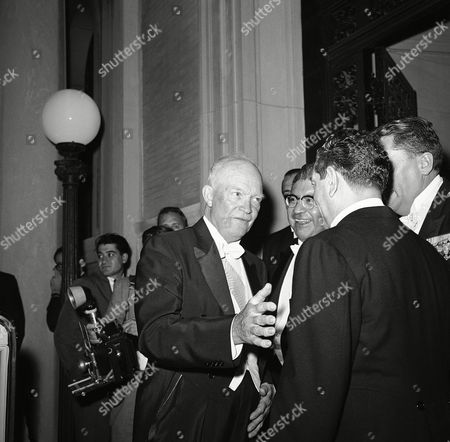 """President Dwight Eisenhower reaches to shake hands with President Adolfo Lopez Mateos of Mexico, after dinner and reception at night on in Washington at the Mexican Embassy where the Chief Executive was a guest. Eisenhower thanked President Mateos for """"a very pleasant evening."""" At center is Mexican Ambassador Antonio Carrillo Flores"""