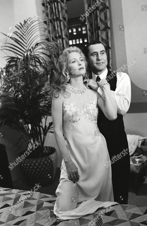 "Faye Dunaway, as Eva Peron, and James Farentino as her husband, Argentine President Juan Peron, go through scene from new NBC-TV movie ""Evita Peron,"" during taping and photo session in Los Angeles, . The jewels in Miss Dunaway's necklace, bracelet, and earrings are real, including diamonds all perfect stones totaling about 270 carats and valued at more than $13 million"
