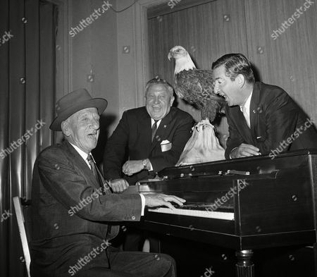 Comedian Jimmy Durante beats out a lot of jive at the keyboard and former King Peter of Yugoslavia, right, sings between sessions at convention of Fraternal Order of Eagles in Chicago . Enjoying the music is Herschel McWilliams, center, of Kansas City, Kan., incoming grand worthy president of the Eagles