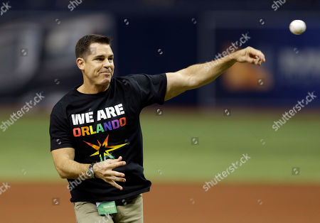 Billy Bean Bill Bean, MLB's vice president of Social Responsibility and Inclusion, throws out the ceremonial first pitch before a baseball game between the Tampa Bay Rays and the San Francisco Giants, in St. Petersburg, Fla