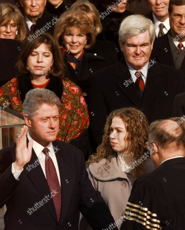 "Stock Image of CLINTON GINGRICH In this Jan. 20, 1997 photo, President Clinton is sworn in for his second term by Supreme Court Chief Justice William Rehnquist during the 53rd Presidential Inauguration, in Washington. His daughter Chelsea is at his side. House Speaker Newt Gingrich of Georgia and his wife Marianne are in the background. Dredging up a past that Newt Gingrich has worked hard to bury, the GOP presidential candidate's ex-wife says Gingrich asked for an ""open marriage"" in which he could have both a wife and a mistress. In an interview with ABC News' ""Nightline"" scheduled to air Thursday, Jan. 19, 2012, Marianne Gingrich said she refused to go along with the proposal that she share her husband with Callista Bisek, who would later become his third wife"
