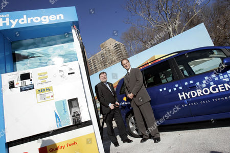 Jeremy Bentham, left, CEO of Shell Hydrogen, and Larry Burns, General Motors vice president research, development and planning, pose with a HydroGen3 fuel cell car at a mock-up Shell hydrogen fueling station in New York, . GM willwill be providing 13 fuel cell-powerred vehicles and Shell Hydrogen LLC intends to establish New York state's first hydrogen service station in New York City by 2006