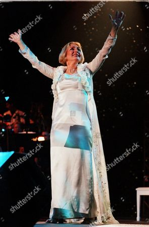 Stock Image of GOOGOOSH Iranian pop singer Googoosh acknowledges fans during a three hour concert, Saturday night, in Inglewood, Calif. This was her first concert in the United States since she broke two decades of silence. A cultural icon in Iran in the 1960s and 1970s, Googoosh was forced to end her acting and singing career after the 1979 revolution and lived an isolated life in a Tehran apartment. The isolation was interrupted when a more moderate government under President Mohammad Khatami, elected in 1997, allowed her to travel abroad again