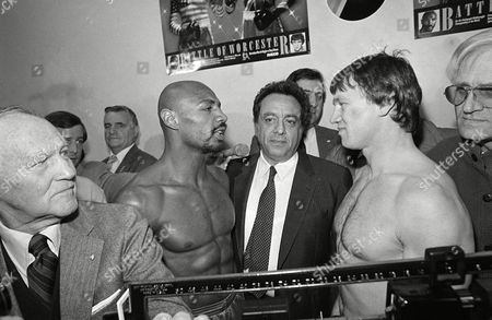 Middleweight Champion, Marvelous Marvin Hagler of Brockton, Mass.,left, gets face to face with oppent Tony Sibson, right, after the weight in at the Centrum in Worcester, Mass. In the center of the two is Jose Sulaiman, President of the World Boxing Association. Sibson will be meeting Hagler Friday night for the title at the Centru