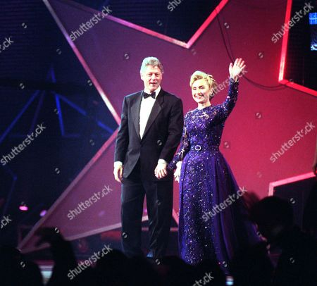 CLINTON President Clinton and Hillary Rodham Clinton appear at the MTV Ball at the Washington Convention Center . New York fashion designer Oscar de la Renta created a long embroidered tulle gown with matching cape that Mrs. Clinton will wear to the 1997 inaugural balls, the White House said. In going to de la Renta, Mrs. Clinton selected a more established fashion couturier to outfit her than the designer she hired four years ago. Sarah Phillips, who designed the violet-and-lace creation Mrs. Clinton wore to the 1993 inauguration, had less than two years experience as a designer