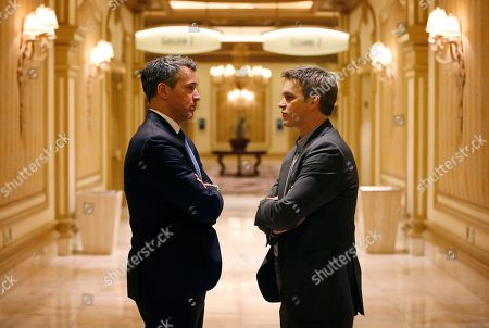 Stephane Quintal, Luc Robitaille Stephane Quintal, left, senior vice president of player safety with the NHL, land Luc Robitaille, president of business operations for the Los Angeles Kings, speak during a meeting of NHL general managers, in Las Vegas