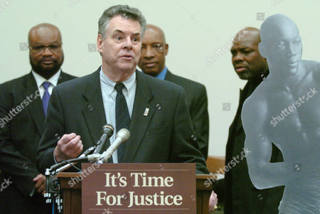 Stock Image of BARKLEY Rep. Peter King, R-N.Y., speaks during a news conference supporting a posthumous pardon for Jack Johnson, the first black heavyweight champion who was convicted in 1913 in a case based on his consensual relationship with a white woman, in Washington. Behind King are Eddie Mustafa Muhammad, left, president of the Joint Association of Boxers, referee Richard Steele, a member of the World Boxing Hall of Fame, and former boxing champion Iran Barkley, right. A lifesize photo of Johnson is at right