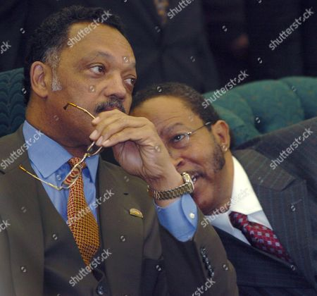 JACKSON HARRIS The Rev. Jesse Jackson, left, listens to Rev. James Harris, right, during the twentieth annual Clayton County ecumenical service in celebration of the national holiday observance of Martin Luther King Day, at the Dixon Grove Baptist Church in Jonesboro, Ga