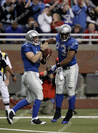 Drew Stanton, John Owens Detroit Lions quarterback Drew Stanton, left, and tight end John Owens celebrate their one yard touchdown reception against the Jacksonville Jaguars in an NFL football game in Detroit