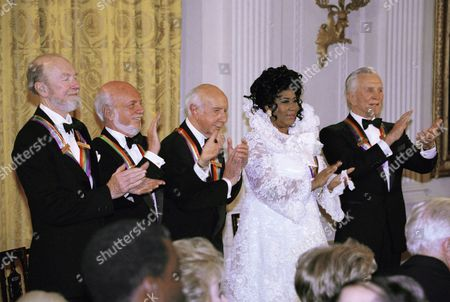 The recipients of the 1994 Kennedy center honors award attend a reception on in the East Room of the White house in Washington. From left to right are songwriter Pete Seeger, director Harold Prince, composer Morton Gould, singer Aretha Franklin, and actor Kirk Douglas