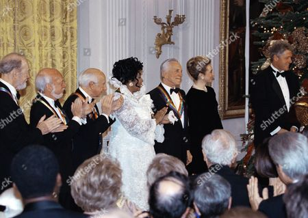 The recipients of the 1994 Kennedy center honors award attend a reception on in the East room of the White house in Washington. From left to right are songwriter Pete Geeger, director Harold Prince, composer Morton Gould, singer Aretha Franklin, and actor Krik Doughlas and the Clintons