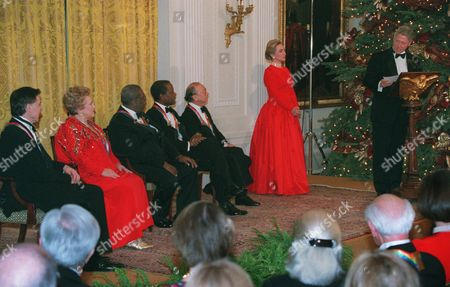 CLINTON President Clinton addresses the five honorees of the Kennedy Center Honors of 1995 in a ceremony in the East Room of the White House, in Washington as first lady Hillary Rodham Clinton listens. The honorees from left are Jacques d'Amboise, Marilyn Horne, B.B. King, Sidney Poitier and Neil Simon