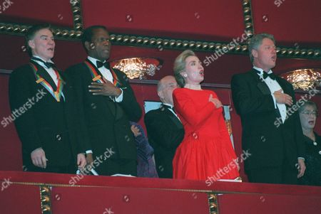 President Clinton sings the national anthem with from left, Kennedy Center Honorees Jacques d'Amboise, Sidney Poitier and first lady Hillary Rodham Clinton, at the 18th Annual Celebration of the Performing Arts at the Kennedy Center, in Washington. Kennedy Center Honors of 1995 were given to Marilyn Horne, B.B. King, Neil Simon, d'Amboise and Poitier
