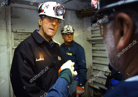 KERRY ROBERTS Democratic presidential candidate Sen. John Kerry, D-Mass., left, speaks with Cecil Roberts, president of the United Mine Workers of America, right, while touring the McElroy Mine, in Glen Easton, W. Va., . The coal mine extends for miles underground and is over a thousand feet deep