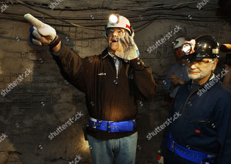 KERRY ROBERTS Democratic presidential candidate Sen. John Kerry, D-Mass., left, yells out for visitors to the McElroy Mine to beware of low hanging electrical wires during a tour of the coal mine in Glen Easton, W. Va., . President of United Mine Workers of America Cecil Roberts looks on at right