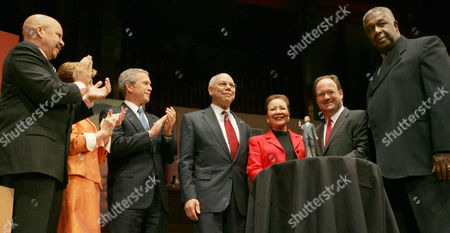 "Stock Picture of THOMPSON Secretary of State Colin Powell, fourth from left, and his wife Alma, center, receive the 2005 '""John Thompson Legacy of a Dream Award'"" during ceremonies at Georgetown University's ""Let Freedom Ring"" celebration honoring Dr. Martin Luther King, Jr. at the John F. Kennedy Center for the Performing Arts, in Washington. Also on stage from left to right are, Radio Personality Tom Joyner, first lady Laura Bush, President Bush, John DeGioia, President of Georgetown University and John Thompson, former head coach of the Georgetown University Men's Basketball team"