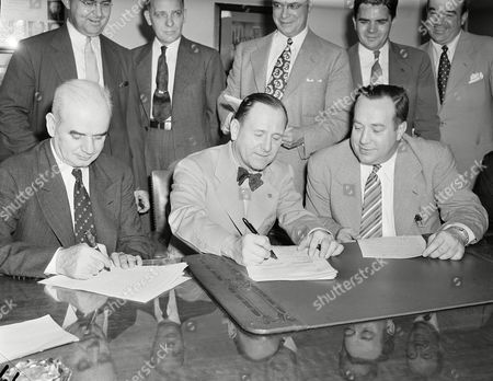 Harry Bennett, Philip Murray, R.J. Thomas President Philip Murray, left, of the CIO, Harry Bennett, center, director of personnel of the Ford Motor Company, and R.J. Thomas, president of United Auto Workers (UAW), sign the first union contract ever entered into by the Ford Motor Company, in Washington, D.C