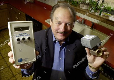 SWIFT David Swift, president of FloodStoppers of Austin, Inc., holds some of the parts to a system that detects household leaks and then automatically shuts off main water valves, at his home in San Antonio. Swift says that by catching leaks early, the system can avoid the constant dripping that leads to mold