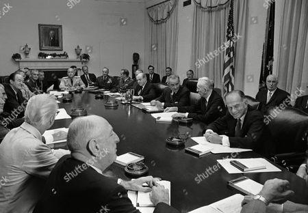 U.S. President Lyndon Johnson conferred with congressional leaders on Aug.13, 1963 in Washington. From left, clockwise are: Sen. W. Russell, D-Ga., Rep. M. Rivera, D-S.C.; Sen. J. Sparkman, D-Ala.; Sen. E. Dirksan, R-Ill.; Vice-president Hubert Humphrey; Gen. L. Chapman; Gen. Wm. Westmoreland, Army Chief of Staff; Sen. J. Randolph, D-W. Va.; Adm T. Moorer, Chief of Naval Operations; Rep. G. Ford, R-Mich.; Gen. J. McConnell, Air Force Chief of Staff; Gen. M. Wheeler, Chairman Joint Chief of Staff; Defense Sec. C. Clifford; Secretary of State Deaqn Rusk; President Johnson; House Speaker J. McCormack and Sen. W. Fulbright, D-Ark