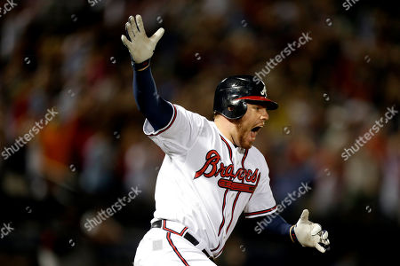 Freddie Freeman, Terry Pendleton Atlanta Braves' Freddie Freeman hits a two-run home run in the ninth inning to beat the Miami Marlins 4-3 to clinch the wild card, in Atlanta