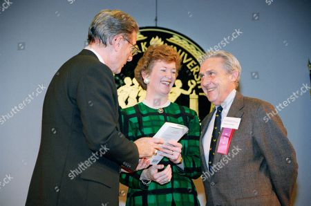 Mary Robinson President of Ireland Mary Robinson, center, receives a copy of ?The End of Hidden Ireland: Immigration and Famine 1830-1848? from New York University President L. Jay Oliva, left, as the book?s author, Robert Scally, NYU professor of history and director of the university?s Ireland House, looks on in New York. Robison was on hand to deliver the keynote address at the university?s International Conference on Hunger, hosted by Ireland House
