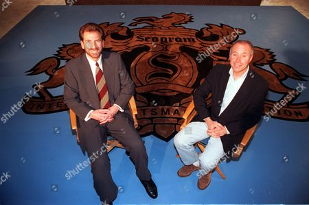 Bronfman Geffen Edgar Bronfman Jr., president and chief executive officer of the Seagram Co. Ltd., left, and David Geffen, co-creator of DreamWorks, pose at MCA's Universal Studios in Universal City, Ca., . The Seagram Co. Ltd., which owns most of MCA Inc., won key distribution rights to the new DreamWorks studio's movies, home videos and music