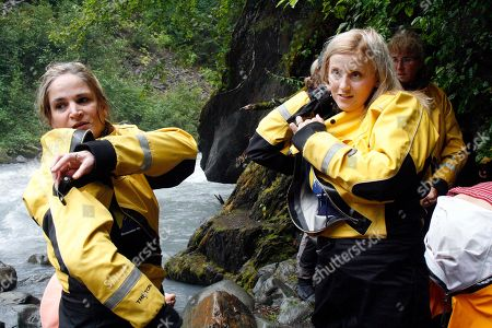 Stock Image of Julie Robinson, Jennifer Hankins Julie Robinson of Ligonier, Pa., left, and Jennifer Hankins of San Diego, put on wet suits before a white water rafting trip on Crow Creek, near Girdwood, Alaska during an Alaska Adventure excursion. The event was organized by Tragedy Assistance Program for Survivors for a group of about 75 widows of military veterans to share memories of loved ones while while hiking rugged trails and rafting the rapids