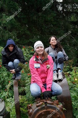 """Stock Photo of Julie Robinson, Jennifer Hankins, Jennifer Tullis From left, Julie Robinson, of Ligonier, Pa., Megan Griffin of Long Beach, Calif., and Jennifer Tullis of San Diego, perch and make an """"owl"""" face, at the Crow Creek Gold Mine near Girdwood, Alaska, during an Alaska Adventure excursion. The event was organized by Tragedy Assistance Program for Survivors for a group of about 75 widows of military veterans to share memories of loved ones while while hiking rugged trails and rafting the rapids"""
