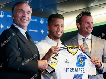 Giovani dos Santos Los Angeles Galaxy coach Bruce Arena, left, and team president Chris Klein, right, pose for a photo with the team's new forward Giovani dos Santosduring an introductory news conference in Carson, Calif., on . After four years of courting dos Santos, the Galaxy signed the highest-profile Mexican star in their history to a designated player contract, paying a reported $7 million transfer fee. He is expected to make his Major League Soccer debut on Sunday against the Seattle Sounders FC