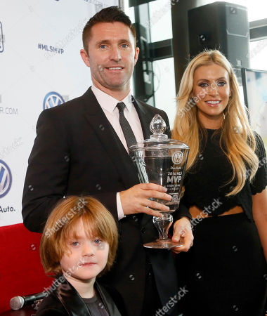 Robbie Keane, Claudine Keane, Robert Keane Los Angeles Galaxy forward Robbie Keane displays his trophy with his wife Claudine and son Robert, 5, after being named Major League Soccer's MVP after the Irish forward's dynamic season for the Galaxy, at an awards ceremony in Los Angeles, . New England's Lee Nguyen and Seattle's Obafemi Martins were the other finalists for the award. The 34-year-old Keane had 19 goals and 14 assists while leading the Galaxy's MLS-best offense, providing dangerous attacking and steady leadership for the MLS Cup finalists