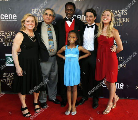 """QuvenzhanÈ Wallis, Dwight Henry, Nancy Utley, Steve Gilula, Dwight Henry, Benh Zeitlin, Lucy Alibar, QuvenzhanÈ Wallis Cast members and Fox Searchlight executives pose on the red carpet at the movie premiere of """"Beasts Of The Southern Wild"""" at the Joy Theater in New Orleans, . From left are Fox Searchlight co-presidents Nancy Utley and Steve Gilula, actor Dwight Henry, director and co-writer Benh Zeitlin, co-writer Lucy Alibar and actress Quvenzhane Wallis"""