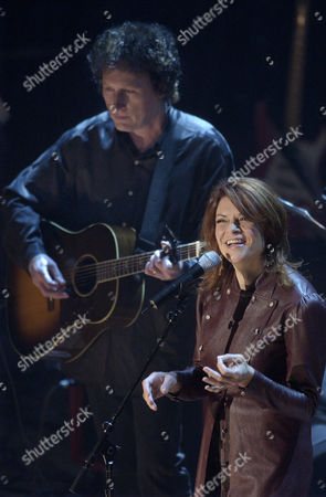 CASH SCRUGGS Rosanne Cash, daughter of Johnny Cash performs accompanied by Randy Scruggs during the Johnny Cash Memorial Tribute at the Ryman Auditorium in Nashville, Tenn. Cash died on Sept. 12, 2003 at the age of 71, from complications of diabetes