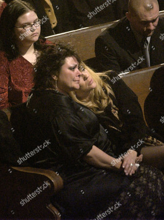 CASH CARTER Kathy Cash, daughter of Johnny Cash, left, and Carlene Carter embrace during the Johnny Cash Memorial Tribute at the Ryman Auditorium in Nashville, Tenn. Cash died on Sept. 12, 2003 at the age of 71, from complications of diabetes