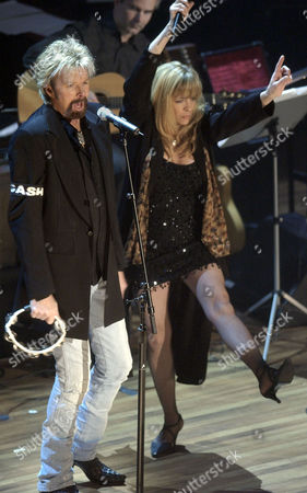 DUNN CASH Ronnie Dunn of the duo Brooks and Dunn performs along with Carlene Carter, daughter of June Carter Cash during the Johnny Cash Memorial Tribute at the Ryman Auditorium in Nashville, Tenn. Cash died on Sept. 12, 2003 at the age of 71, from complications of diabetes. The coat that Dunn is wearing was given to him by Johnny Cash early in his career