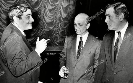 NBC President Fred Silverman, left, talks with Mike Weinblatt, president of the entertainment division of NBC, center, and Bob Mulholland, president of the NBC television network, right, during a meeting in Los Angeles, Calif., on