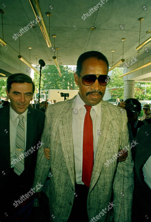 NFL Players Association executive director Gene Upshaw arrives at the Four Seasons Hotel in Philadelphia, to meet with NFL Management Council's Jack Dolan as negotiations in the day-old NFL players strike continues