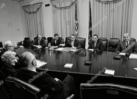 President Richard Nixon met in the White House Cabinet Room with five Republican senators from the New England area, in Washington. Clockwise, starting center foreground: Sen. Norris Cotton of New Hampshire; Sen. Margaret Chase Smith of Maine; Sen. George Aiken of Vermont; Robert Ellsworth, presidential aide; Sen. Edward Brooke of Massachusetts; Nixon; and Sen. Winston Prouty of Vermont