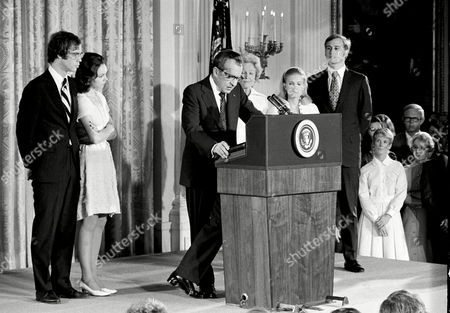 Associated Press Domestic News Dist. of Columbia United States NIXON RESIGNATION President Nixon reads a passage from a book by Theodore Roosevelt as he addresses an East Room White House audience . Julie Nixon Eisenhower and her husband David listen, left, along with Mrs. Pat Nixon, Tricia Nixon Cox and her husband stand at the right