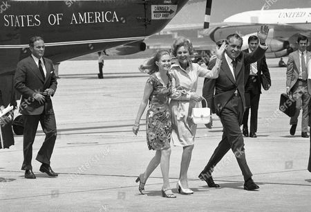 Alexander Haig, Tricia Nixon, Pat Nixon, Richard Nixon President Richard Nixon and first lady Pat Nixon wave as they walk beside daughter Tricia Nixon Cox on their way to board the presidential jet for a flight to Florida, at Andrews Air Force Base. White House Chief of Staff Alexander Haig follows behind the Nixons