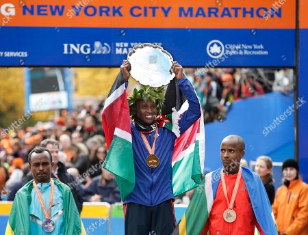 Tsegaye Kebede, Geoffrey Mutai, Lusapho April Second place finisher Tsegaye Kebede, left, of Ethiopia, and Lusapho April, right, of South Africa flank men's marathon winner Geoffrey Mutai of Kenya after they came in second, first and third in the men's division of the New York City marathon, in New York