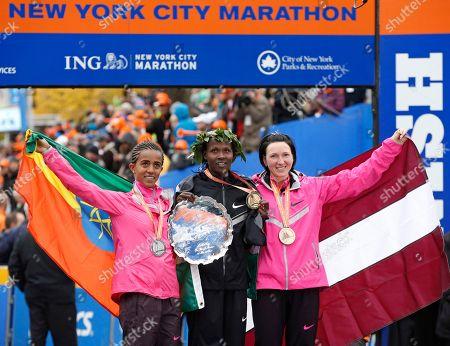 Buzunesh Deba, Priscah Jeptoo, Jelena Prokopcuka Women's winner Priscah Jeptoo of Kenya, center, second place finisher Buzunesh Deba of Ethiopia, left, and third place finisher Jelena Prokopcuka of Latvia pose with their medals after the New York City Marathon, in New York
