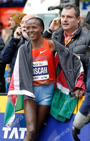 Priscah Jeptoo Women's winner Priscah Jeptoo of Kenya reacts with members of her team after coming in first in the women's division of the New York City marathon, in New York